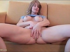 Lana Wilder models fake tits and drains solo
